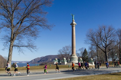 Runners pass Trophy Point during the West Point Half-Marathon Fallen Comrades Run at the United States Military Academy in West Point, New York. The Hudson River is visible in the background at left.
